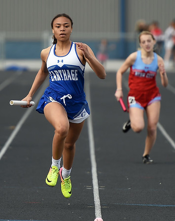 Carthage's Allanna O'Hare, left, anchors the Tigers to a first place finish in the girls 4x200 during the 35th Annual Carthage Invitational on Thursday at CHS. Also pictured is Webb City's Kate Young.<br /> Globe | Laurie Sisk