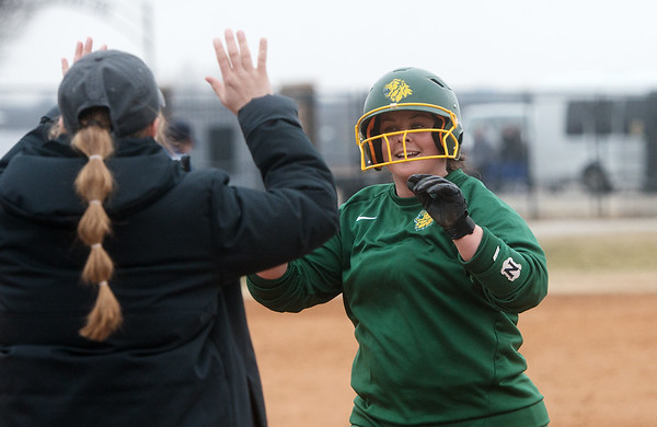 Missouri Southern's Erika Lutgen celebrates a double with her coach during Friday's game against William Jewell at Missouri Southern.<br /> Globe | Roger Nomer