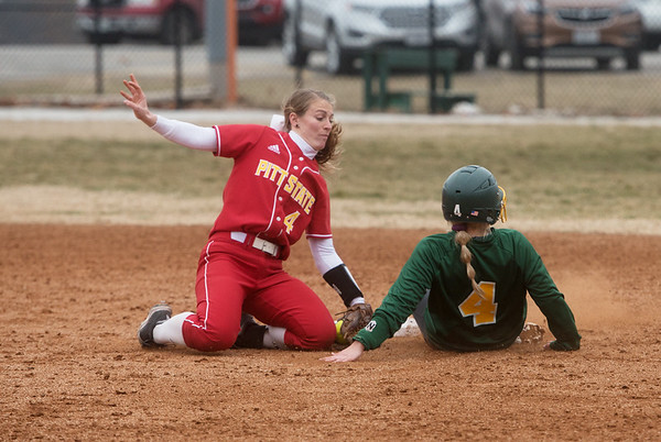 Missouri Southern's Sidnie Hurst slides past Pittsburg State's Brittanee Knepper to steal second during Friday's game at Missouri Southern.<br /> Globe   Roger Nomer