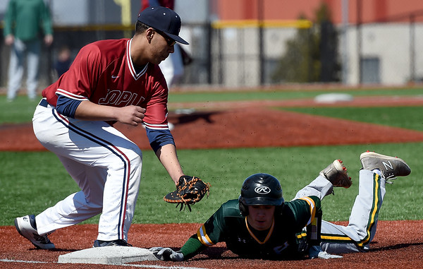 Joplin first baseman Maurie Auberry, left, tries to pick off Parkview's xx (4) during their game on Saturday at JHS. <br /> Globe | Laurie Sisk