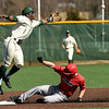 Missouri Southern second baseman Dexter Swims leaps for an errant throw as Drury's Clayton Engel slides safely into second base during their game on Wednesday afternoon at Warren Turner Field.<br /> Globe | Laurie Sisk