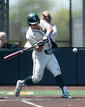 Missouri Southern's Troy Gagan connects for a grand slam during the Lions game against Northeastern State on Saturday at Warren Turner Field.<br /> Globe | Laurie Sisk