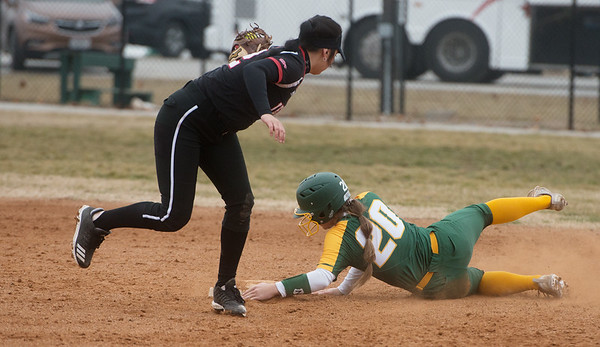 Missouri Southern's Makaila Leonhart slides under a tag from William Jewell's Emily Hoover to steal second during Friday's game at Missouri Southern.<br /> Globe | Roger Nomer