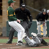 Missouri Western's Zach Pych slides home well ahead of the throw as Missouri Southern pitcher Will Bausinger covers the plate during their game on Saturday at Warren Turner Field.<br /> Globe | Laurie SIsk