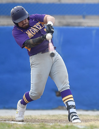 Monett's Alex Rivera fouls back a pitch during the Cubs game against Seneca in the 45th Annual Bill O'Dell Tournament on Tuesday night at Carthage's Carl Lewton Stadium.<br /> Globe | Laurie Sisk