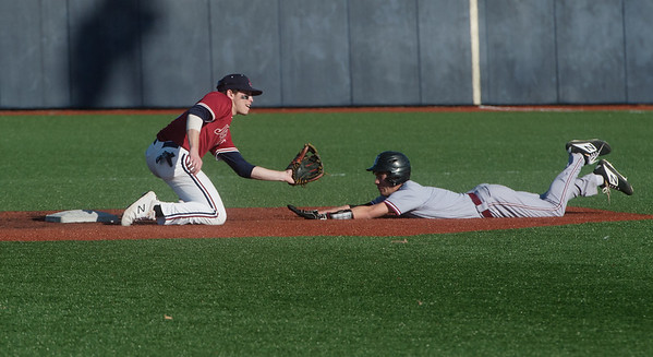 Nevada's Grant Miller steals second ahead of a tag from Joplin's Grant Jones during Thursday's game at Joplin High School.<br /> Globe | Roger Nomer