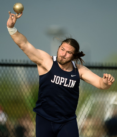 Joplin's Dylan Wemer throws for a personal record en route to a first place finish in the shot put during the Joplin Invitational on Wednesday at JHS.<br /> Globe | Laurie Sisk