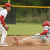Webb City's Jacob Monroe (11) slides safely into second base as Carl Junction's Drew Beyer (15) awaits the throw during their game on Tuesday at Carl Junction.<br /> Globe | Laurie Sisk