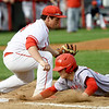 Webb City's Shane Noel , right, slides safely back into first base as Carl Junction first baseman Cooper Cook gloves the throw on a pick-off attempt during their game on Tuesday at Carl Junction.<br /> Globe | Laurie Sisk