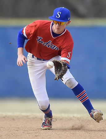 Seneca shortstop Parker Wolfinbarger tracks down a sharply hit grounder during the Indians game against Monett in the 45th Annual Bill O'Dell Tournament on Tuesday night at Carthage's Carl Lewton Stadium.<br /> Globe | Laurie Sisk