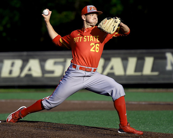 Pittsburg State's Alex Achtermann delivers a pitch to the plate during the Gorillas game against Missouri Southern on Friday at Warren Turner Field.<br /> Globe | Laurie Sisk