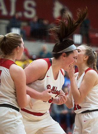 Carl Junction's Katie Scott lets out a scream after making a bucket and getting fouled during Friday's District 12 Championship at Webb City.<br /> Globe | Roger Nomer