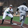 Missouri Southern's Matt Miller fields the out at first base on Missouri Western's Nolan Monthei during Friday's game at Missouri Southern.<br /> Globe | Roger Nomer