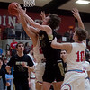 Neosho's Samuel Cradduck grabs a rebound from Webb City's Jaystin Smith (22) and Gary Clinton (10) during Friday's District 12 Championship at Webb City.<br /> Globe | Roger Nomer