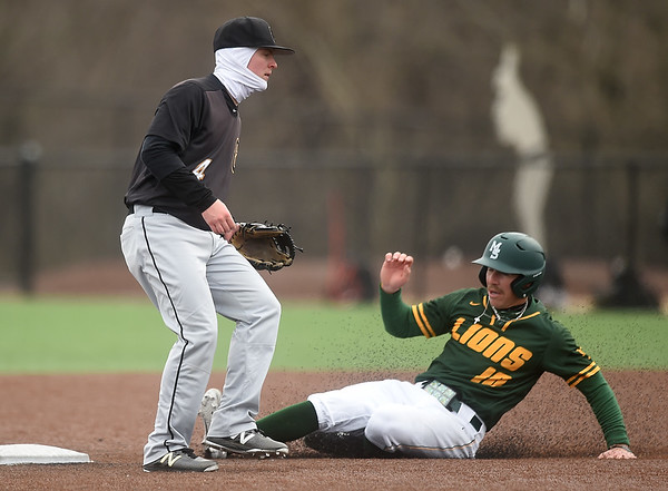 Missouri Southern's Denver Coffee (10) slides well ahead of the throw for a stolen base as Missouri Western's Zach Pych (4) mans the base during their game on Saturday at Warren Turner Field.<br /> Globe | Laurie SIsk