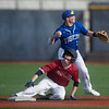 Joplin's Tyler Ledford slides safely past Carthage's Kaden Kralicek during Monday's game at Joplin High School.<br /> Globe | Roger Nomer