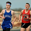 Lamar's XX, right, tries to catch Carthage's XX during their 1600m race at the 35th Annual Carthage Invitational on Thursday at CHS.<br /> Globe | Laurie Sisk