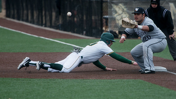 Missouri Southern's Denver Coffee get safely back to first base as Missouri Western's Will Jibas fields the throw during Friday's game at Missouri Southern.<br /> Globe | Roger Nomer