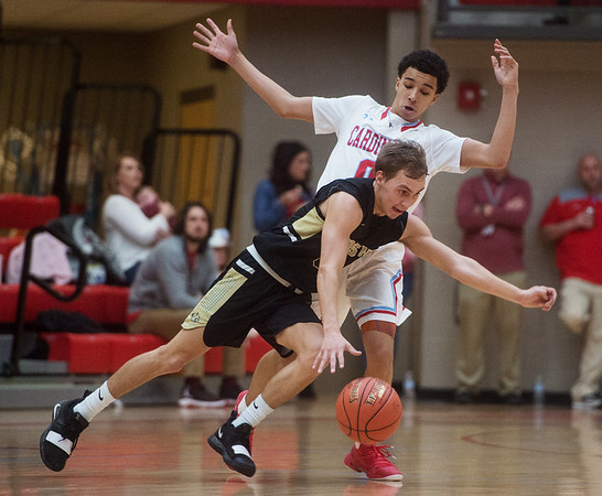 Neosho's Cole Seward dribbles past Webb City's Mekhi Garrard during Friday's District 12 Championship at Webb City.<br /> Globe | Roger Nomer