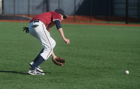 Joplin's Josh Wells charges a grounder during Thursday's game against Nevada at Joplin High School.<br /> Globe | Roger Nomer