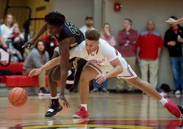 Webb City's Terrell Joseph Kabala and Neosho's Samuel Allan Cook fight for a loose ball during Friday's District 12 Championship at Webb City.<br /> Globe | Roger Nomer