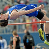 Defending state champion Dylan Pruiett clears 6 feet, 8 inches to claim first place in the high jump for the Carthage Tigers during the 35th Annual Carthage Invitational on Thursday at CHS.<br /> Globe | Laurie Sisk