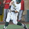 Missouri Southern's Alex Phillips connects for an rbi single during the Lions game against Pittsburg State on Friday at Warren Turner Field.<br /> Globe | Laurie Sisk
