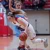 Carl Junction's Danielle Wrensch dribbles past Webb City's Alexandra Grace Vanzant during Friday's District 12 Championship at Webb City.<br /> Globe | Roger Nomer
