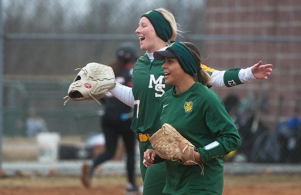 Missouri Southern's Abby Atkin (7) and Josie Tofpi celebrate an inning-ending out on Friday during a game against William Jewell at Missouri Southern.<br /> Globe | Roger Nomer