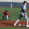 Joplin's Cade Carlson steals third ahead of a tag from Nevada's Trent Pryor during Thursday's game at Joplin High School.<br /> Globe | Roger Nomer