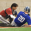 Joplin catcher Luke Benfield, left, tags out Carthage's Bryce Pugh (20) during their game on Tuesday at JHS.<br /> Globe | Laurie Sisk