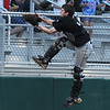 Globe/Roger Nomer<br /> Golden City's Zech Sipes makes a catch on a foulball behind home plate during Wednesday's game.