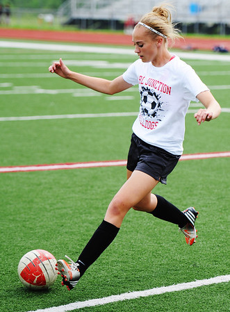 Globe/T. Rob Brown<br /> Carl Junction's Callie Degani takes control of a pass Monday afternoon, May 20, 2013, during practice at Carl Junction's field.