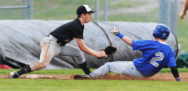 Globe/Roger Nomer<br /> Golden City's Austin Tubaugh tags out McAuley's Adam Robertson at third during Wednesday's game.