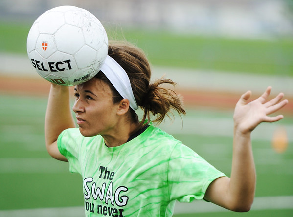 Globe/T. Rob Brown<br /> Carl Junction's Anissa Williams works on her headers Monday afternoon, May 20, 2013, during practice at Carl Junction's field.