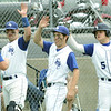 Globe/Roger Nomer<br /> Colgan's Christian Cedeno (22) is congratulated by teammates after scoring a run in Thursday's game against Galena.