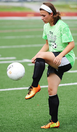 Globe/T. Rob Brown<br /> Carl Junction's Anissa Williams works on her ball handling and control Monday afternoon, May 20, 2013, during practice at Carl Junction's field.