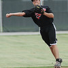 Globe/Roger Nomer<br /> Enrique Finol makes a throw during practice with the Outlaws at Joe Becker Stadium on Wednesday.
