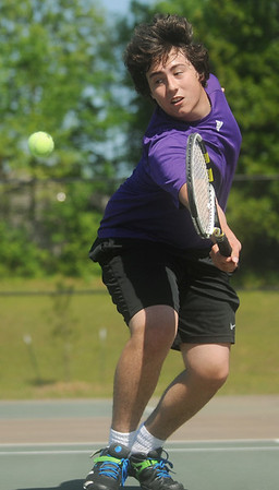 Globe/Roger Nomer<br /> Thomas Jefferson's Frank Cascone stretches to hit a ball during tennis at Thomas Jefferson on Tuesday afternoon.
