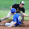Globe/Roger Nomer<br /> McAuley's Nick Wear slides safely into second under a tag from Golden City's Elijah Pitts during Wednesday's game.