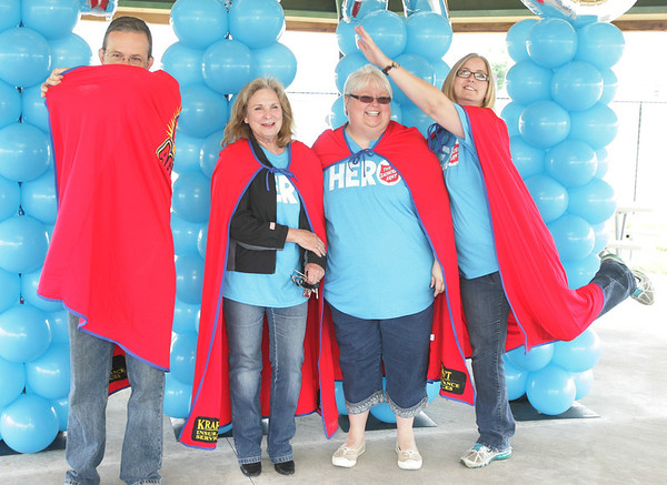 Globe/Roger Nomer<br /> (from left) Bob Hudson, Danette Bray, Regina Duley and Caroline Jones pose in capes for Salvation Army Hero Day at Cunningham Park on Friday afternoon.