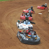 Globe/Roger Nomer<br /> Kart racers take the turn at Eaglewood Speedway during a practice run on Saturday evening.
