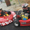 Globe/Roger Nomer<br /> A line of kart racers wait their turn on the track at Eaglewood Speedway on Saturday evening.