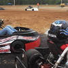 Globe/Roger Nomer<br /> Kart racers watch the competition as they prepare to take the track at Eaglewood Speedway on Saturday.