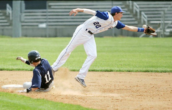 Globe/Roger Nomer<br /> Galena's Kyler Cook slides safely into second as Colgan's Luke Marquardt bobbles the throw during Thursday's game.