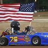 Globe/Roger Nomer<br /> Hayley Ward, 15, Joplin, opens the night session of racing at Eaglewood Speedway with the American flag for the National Anthem.