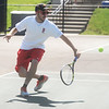 Globe/Roger Nomer<br /> Carl Junction's Ben Coltharp chases down a ball during tennis at Thomas Jefferson on Tuesday afternoon.
