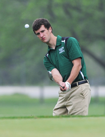 Globe/Roger Nomer<br /> College Heights' Josh Brehm chips onto the green on Monday at Schifferdecker Golf Course.