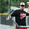 Globe/Roger Nomer<br /> Outlaws Head Coach Rob Vessell throws batting practice on Wednesday at Joe Becker Stadium.