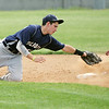 Globe/Roger Nomer<br /> Colgan's Nathan Grimaldi slides safely around a tag from Galena's Alex Bryant during Thursday's game.